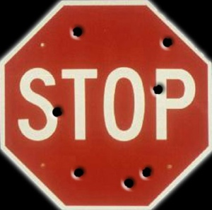 stop-sign-with-bullet-holes1